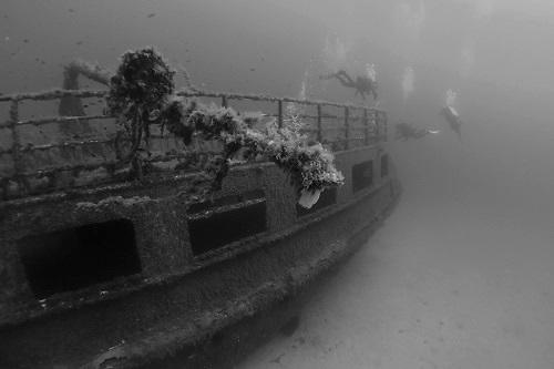 Divers on MV Karwela wreck in Gozo, Malta