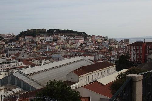 View of houses and Sao Jorge Castle from Miradouro de Sao Pedro de Alcantara viewpoint in Lisbon, Portugal