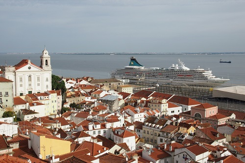 View of the Alfama and cruise ship on the river seen from Miradouro de Santa Luzia viewpoint in Lisbon, Portugal