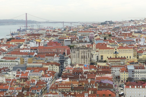View over Se cathedral and 25 of April bridge from Sao Jorge Castle in Lisbon, Portugal