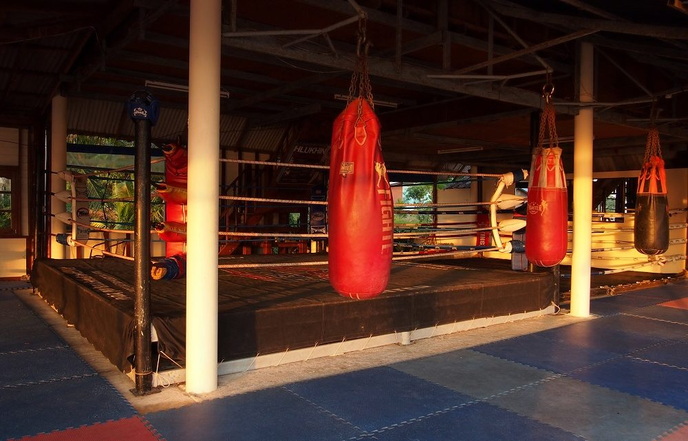 Heavy bags and boxing ring at KYN Muay Thai Camp in Koh Yao Noi, Thailand