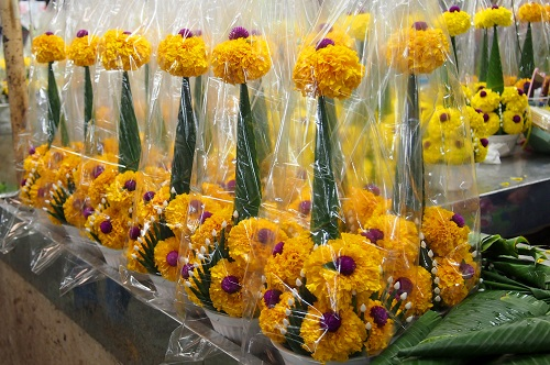 Rows of flower arrangements at a market in Bangkok, Thailand