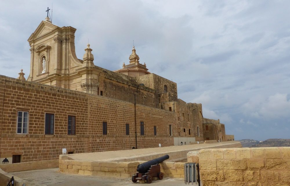 Gozo Cathedral and cannon on wall of citadel in Victoria