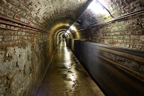 Looking down Victorian brick tunnel at Crumlin Road Gaol in Belfast, Northern Ireland
