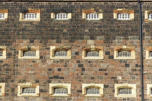 Barred windows of cells at Crumlin Road Gaol in Belfast, Northern Ireland